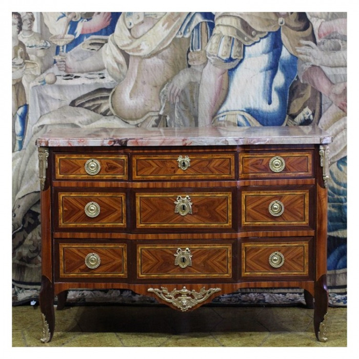 A LOUIS XV/XVI TRANSITIONAL ORMOLU-MOUNTED MAHOGANY, ROSEWOOD AND FRUITWOOD COMMODE, BY JEAN-MARTIN SCHILER, CIRCA 1770.