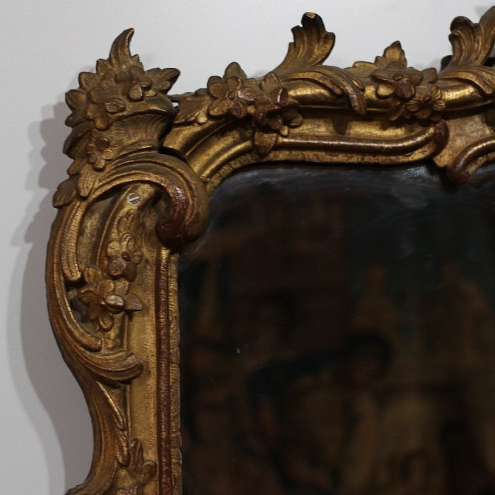 AN EARLY 18TH CENTURY, REGENCE GILTWOOD MIRROR .CIRCA 1720